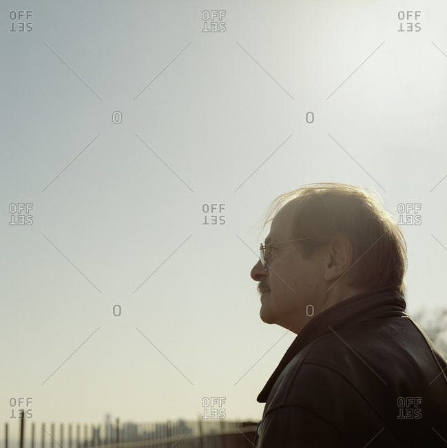 Senior man gazing at the beach