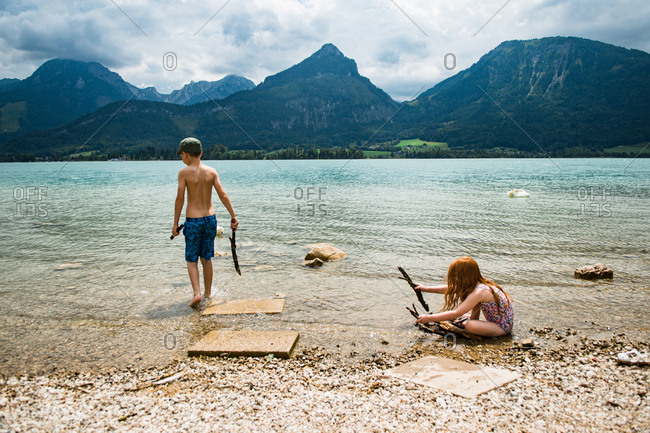 Children playing at a lake in the mountains in Austria