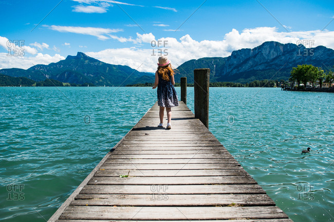 Girl walking at a lake in mountains in Austria