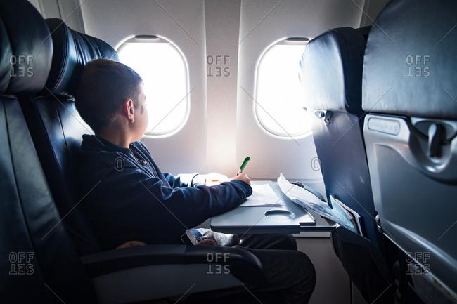 Boy sitting on a plane