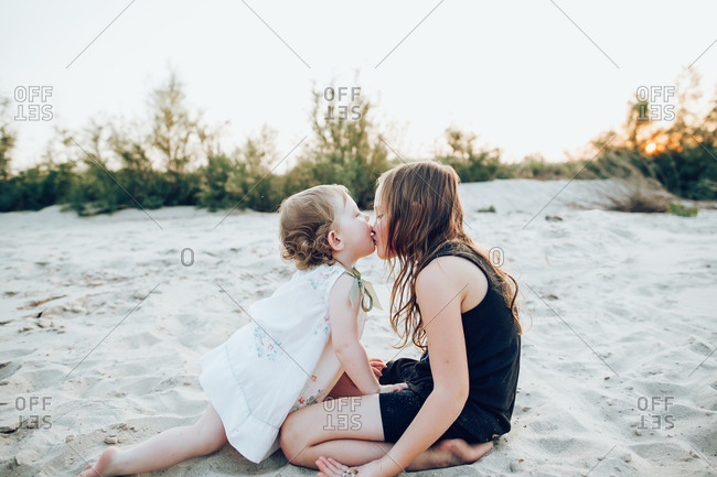 Two girls playing on a sandy riverbed