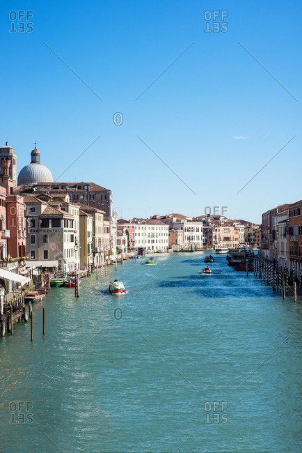 Venice, Italy - February 24, 2016: Boats and gondolas in a Canal in Venice