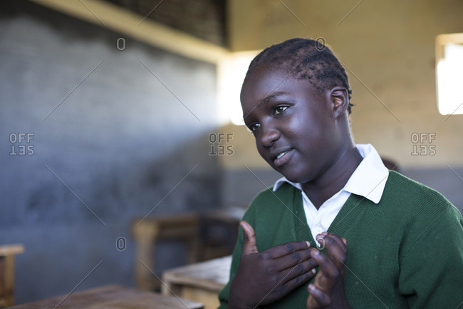 Isiolo, Samburu, Kenya - April 26, 2017: Hearing impaired girl learning sign language, at the Isiolo School for the deaf