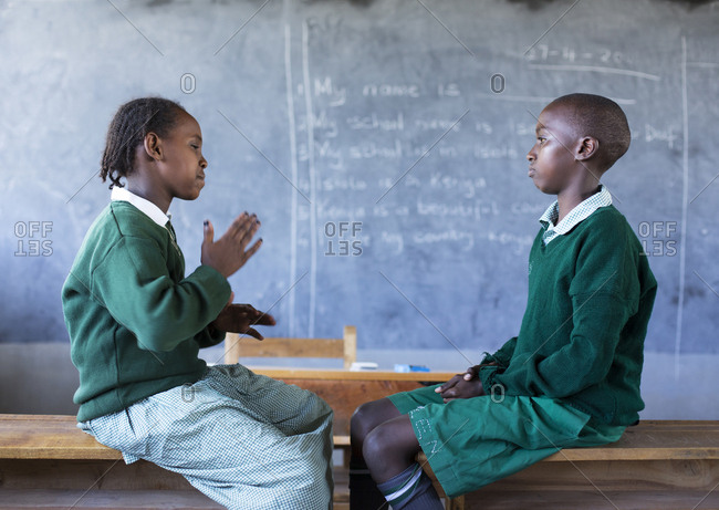 Isiolo, Samburu, Kenya - April 26, 2017: Hearing impaired girl and boy, learning sign language at the Isiolo School for the deaf