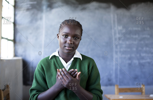 Isiolo, Samburu, Kenya - April 26, 2017: Hearing impaired girl, learning sign language at school Isiolo School for the deaf