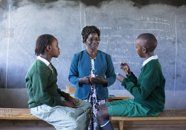 Isiolo, Samburu, Kenya - April 26, 2017: Teacher, teaching hearing impaired school children sign language at the Isiolo School for the deaf
