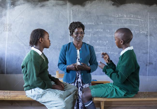 Isiolo, Samburu, Kenya - April 26, 2017: Teacher, teaching hearing impaired school children sign language at the Isiolo School for the deaf