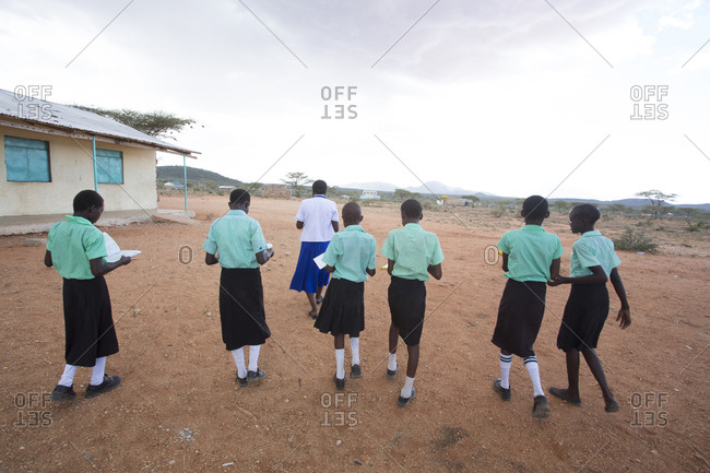 Isiolo, Samburu, Kenya - April 26, 2017: Teacher with school girls outdoors in school at the Lorubae Primary School