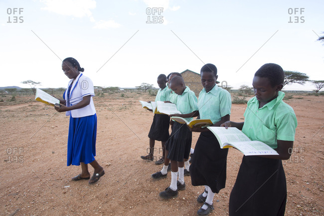 Isiolo, Samburu, Kenya - April 26, 2017: School teacher giving lesson to school girls outdoors at the Lorubae Primary School