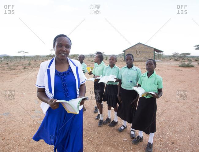 Isiolo, Samburu, Kenya - April 26, 2017: School Teacher with school girls outdoors at the Lorubae Primary School