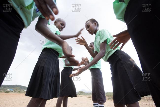 Isiolo, Samburu, Kenya - April 26, 2017: School girls playing outdoors at school  at the Lorubae Primary School