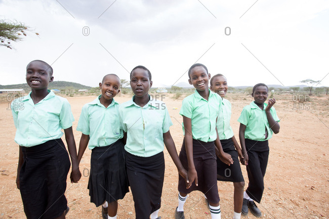 Isiolo, Samburu, Kenya - April 26, 2017: School girls playing outdoors at school at the Lorubae Primary School
