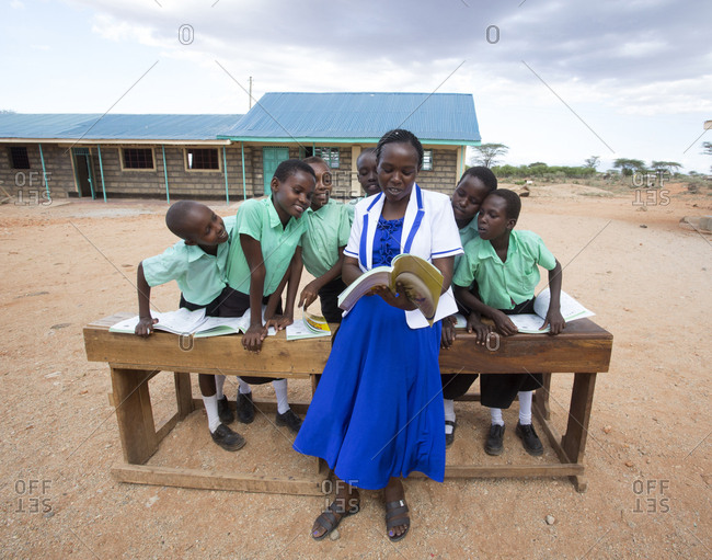 Isiolo, Samburu, Kenya - April 26, 2017: School teacher teaching school girls outdoors at the Lorubae Primary School