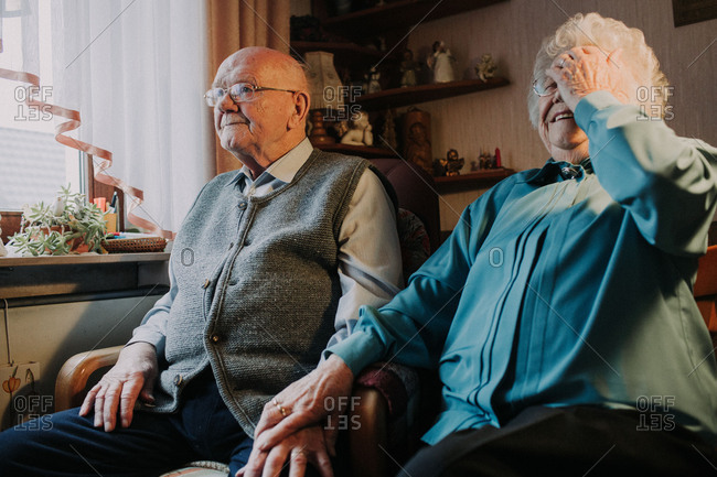 Senior couple at home, woman laughs