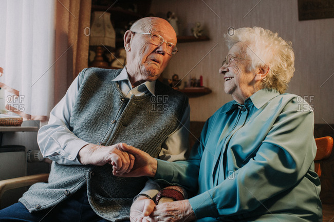 Senior couple grimacing and having fun