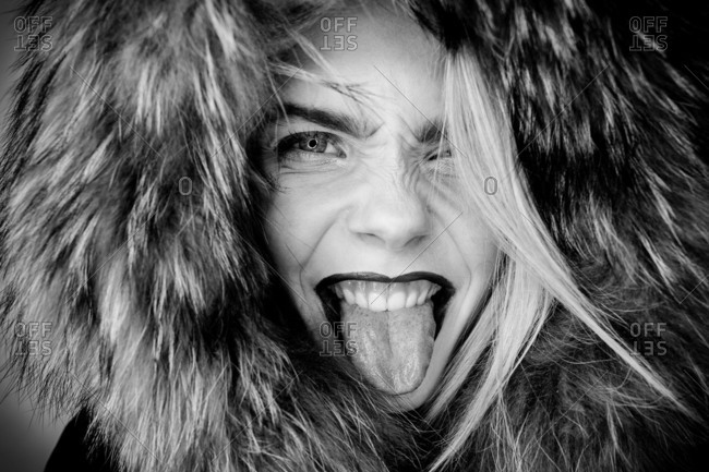young woman with makeup and faux fur hood in Studio