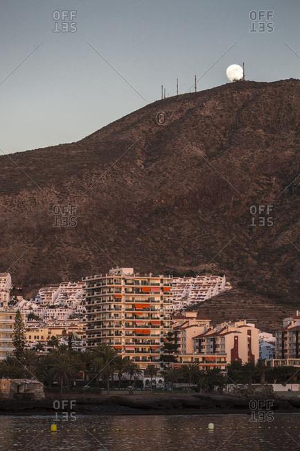 Los Cristianos, Tenerife, Spain - June 28, 2017: Moonrise in Los Cristianos
