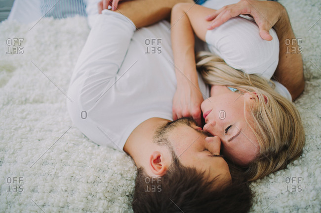 Young couple in love at home in the bed, portrait
