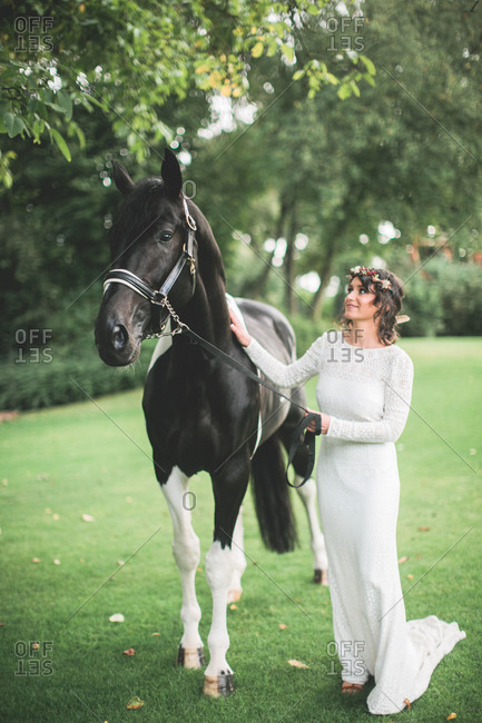 Alternative wedding, bride with horse outside