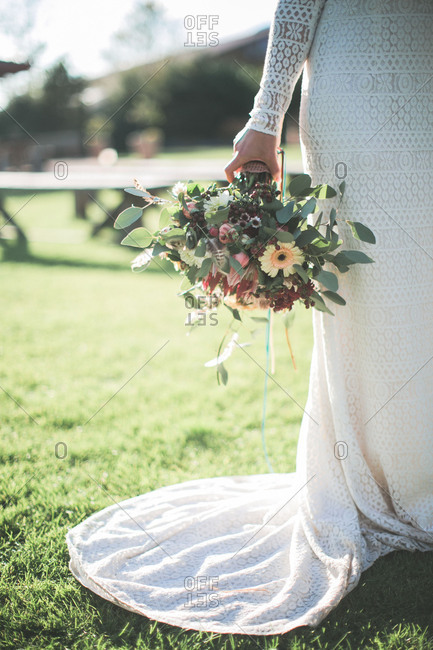 Young bride with bridal bouquet outside, detail