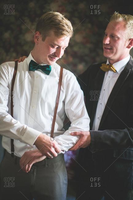 Bridegroom and groomsman, half portrait