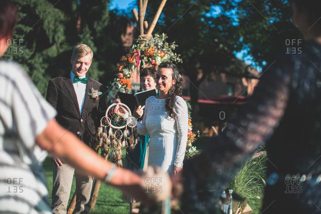 Alternate bridal couple at wedding ceremony outdoors, portrait