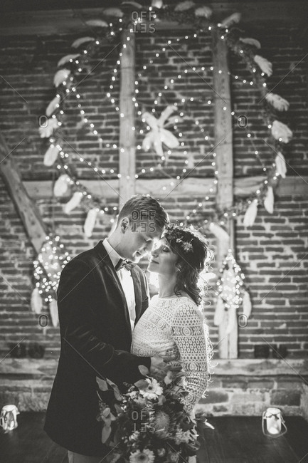 Bride and groom at Indian wedding in barn
