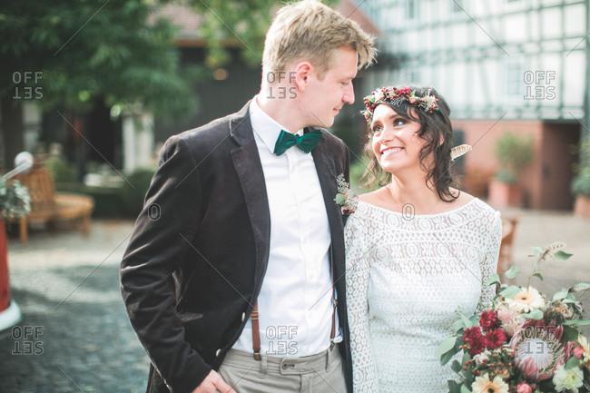 Alternate bridal couple outside, half portrait