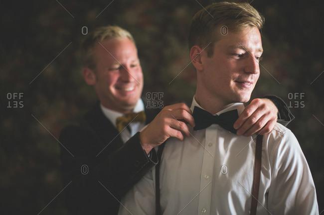 Bridegroom and groomsman, bow tie, help, tie, preparation, portrait