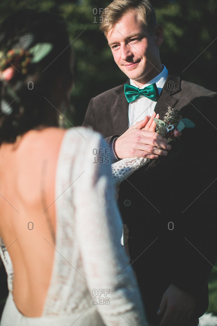 Alternate bridal couple at spiritual wedding ceremony outdoors, lover's vow, portrait