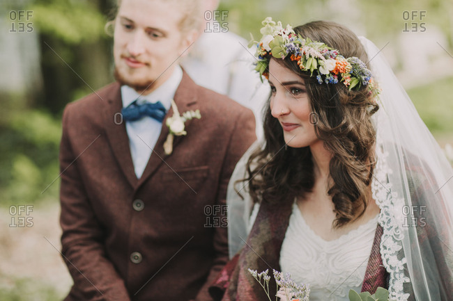Alternate bridal couple at wedding ceremony outdoors, portrait