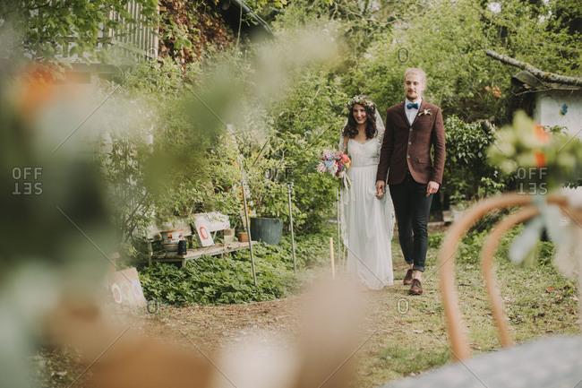 Alternate bridal couple at wedding celebration outside