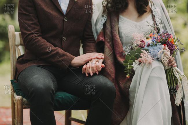 Alternate bridal couple at wedding ceremony outdoors, close up
