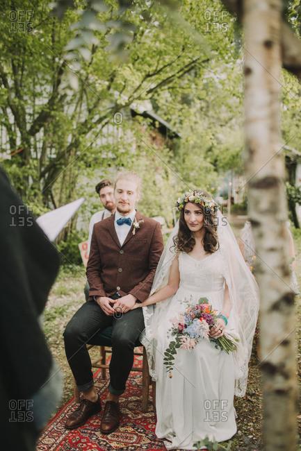 Alternate bridal couple at wedding ceremony outdoors