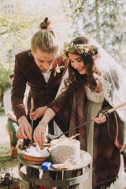 Alternate bridal couple at wedding ritual outdoors