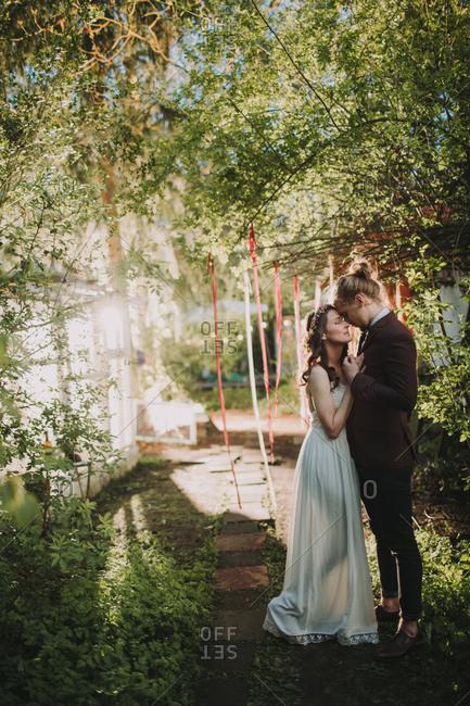 Bride and groom at alternative wedding celebration outside