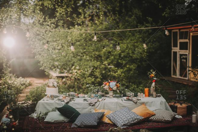 Festive laid table at alternative wedding celebration outside