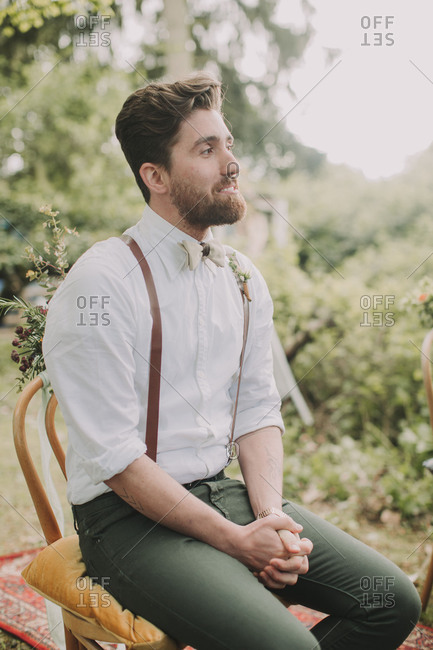 Alternative wedding outside, groomsman traces the ceremony