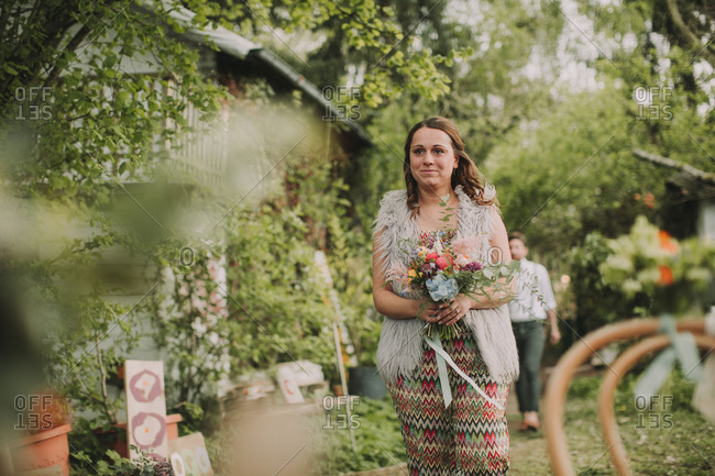 Maid of honor at alternative outdoor wedding, bouquet,
