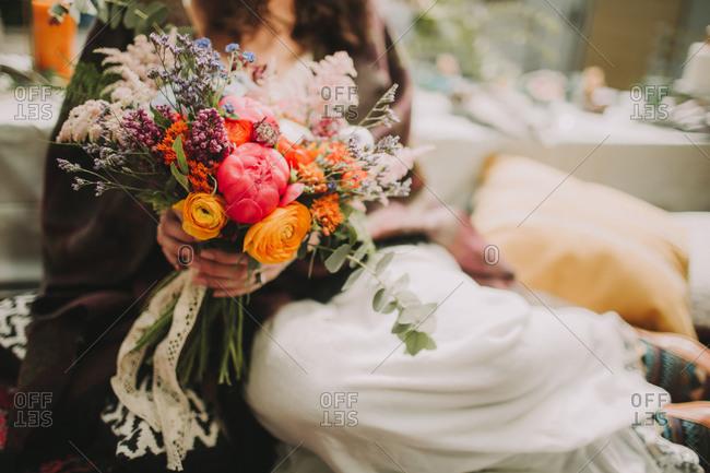 Alternative wedding, bride with bouquet, close up