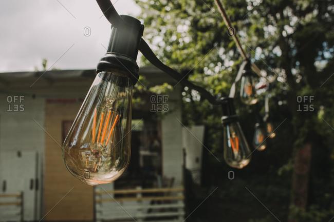 Alternative wedding, garden, decoration, string of lights, evening