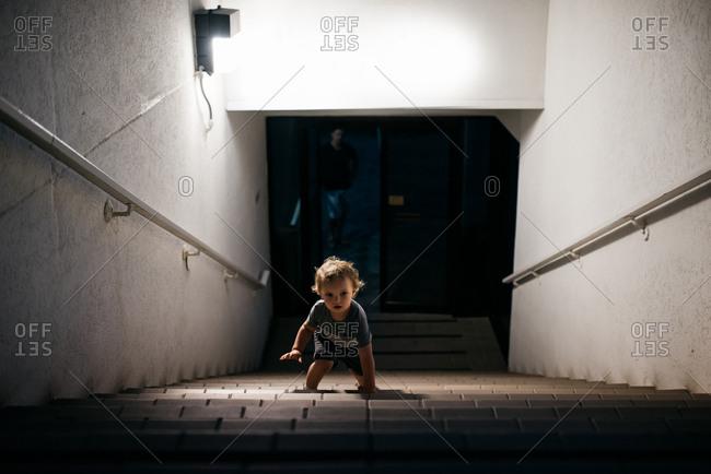 Toddler climbing up stairs