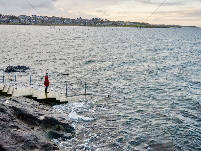 Woman on a ramp into sea in Scotland