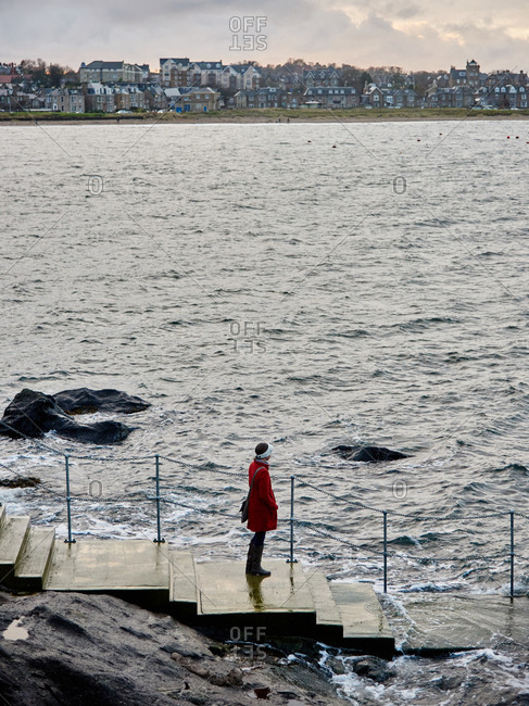 Woman on ramp into sea in Scotland