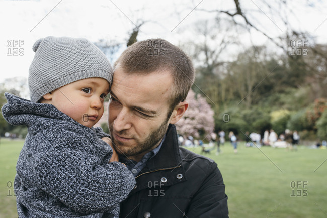 Father holding his son at park