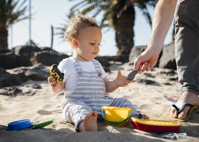 Father and son play at beach