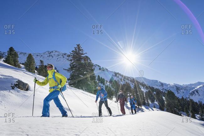 Skiers climbing snow mountain