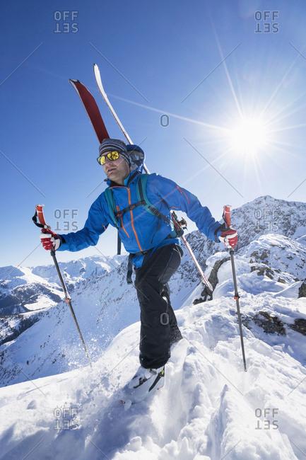 Skier walking on snow mountain