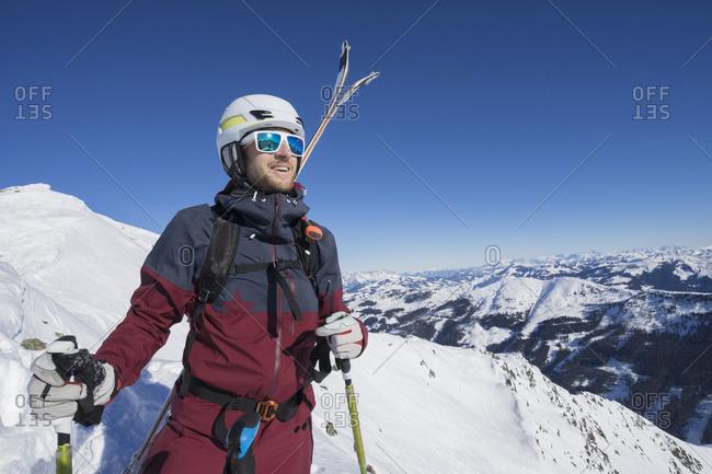 Skier standing on snow mountain