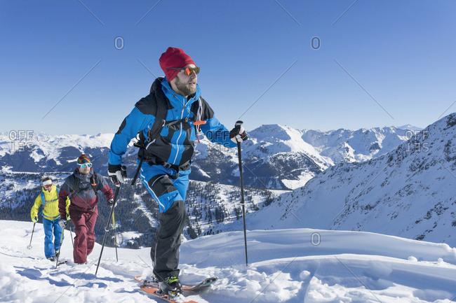 Skiers walking on snow